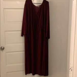 Woman within velvet red faux wrap dress. 34/36W
